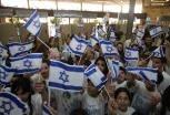 Israeli children wave their national fla