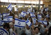 Israeli children wave their national fla